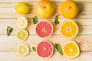 Картинка Лимоны Апельсин Грейпфрут Доски Нарезка Пища