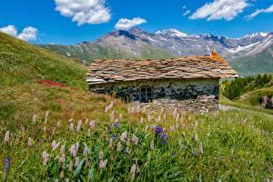 Картинки Гора Франция Здания Альпы Траве Каменные Mont-Cenis, Savoie Природа