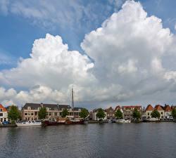 Фотографии Голландия Здания Реки Причалы Облака Haarlem