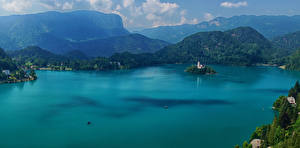 Фотография Словения Горы Озеро Остров Lake Bled Природа