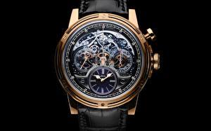 Фото Часы Наручные часы Крупным планом Черный фон Золотые Механизма Шестеренки Louis Moinet Memoris