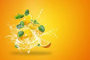 Картинка Апельсин С брызгами Капля Цветной фон Пища