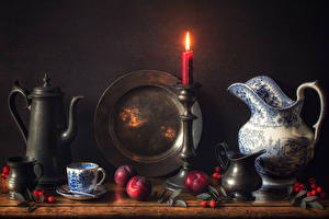 Картинки Натюрморт Свечи Чайник Сливы Кувшины Чашке Шиповник плоды Тарелке