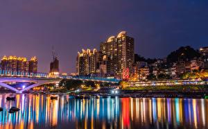 Фото Тайвань Здания Река Мосты Пристань Ночь Лучи света New Taipei город
