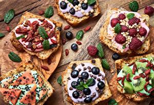 Обои для рабочего стола Хлеб Черника Малина Семечки подсолнечника Киви Арбузы Шоколад Изюм Бутерброд Пища