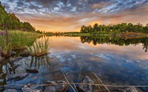Картинка Финляндия Рассветы и закаты Пейзаж Реки Камень Lappeenranta Природа
