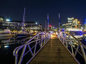 Картинка Австралия Дома Причалы Мост Вечер Лучи света Melbourne город