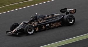 Фотографии Lotus Формула 1 Черная Едущая 1982 Lotus 91 Автомобили Спорт