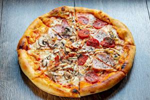 Картинки Фастфуд Пицца Колбаса Ветчина Грибы Продукты питания
