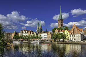 Фотография Германия Здания Речка Пирсы Речные суда Luebeck город