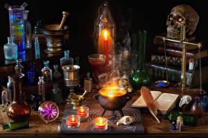 Фотография Хеллоуин Черепа Свечи Пламя Перья Книга Бутылки Стола