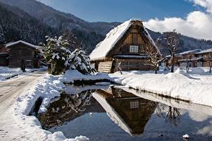 Обои для рабочего стола Япония Здания Зимние Пруд Снега Shirakawa Go город
