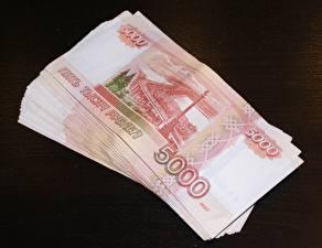Обои Деньги Купюры Крупным планом Рубли 5000