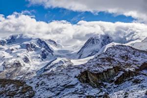 Картинки Гора Швейцария Облака Альпы