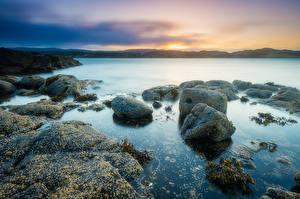 Фотография Камни Побережье Рассветы и закаты Шотландия Kildonan Природа