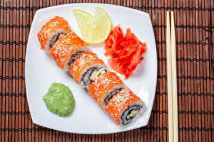 Фотографии Суши Лимоны Рыба Тарелка Палочки для еды
