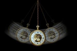 Фото Часы Наручные часы На черном фоне hypnosis