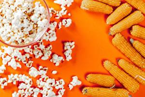 Картинка Кукуруза Цветной фон popcorn Продукты питания
