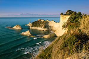 Обои для рабочего стола Греция Волны Берег Море Утес Cape Drastis Corfu Природа