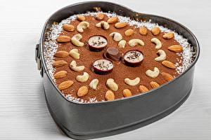Фотография Выпечка Пирог Орехи Шоколад Миндаль Конфеты Какао порошок