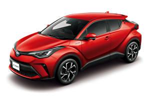 Картинка Toyota Белый фон Красных Гибридный автомобиль 2019 C-HR Hybrid машина