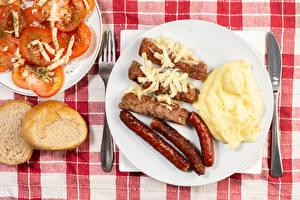 Картинка Сосиска Хлеб Вторые блюда Помидоры Мясные продукты Тарелка Еда