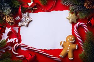 Картинка Новый год Печенье Леденцы Шаблон поздравительной открытки Ветки Дизайн Шишки Лента