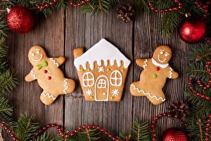 Картинка Новый год Выпечка Печенье Дома Доски Дизайн Шарики Шишки Ветки Еда