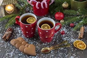 Фото Новый год Чай Печенье Лимоны Кружка Сердце Ложка