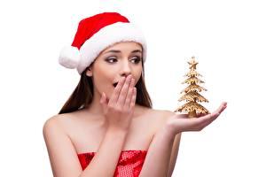 Обои Новый год Белым фоном Шапки Удивление Рука Новогодняя ёлка Девушки