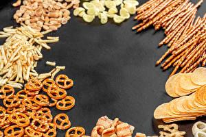 Фотографии Фастфуд Чипсы salted sticks, pretzels Продукты питания