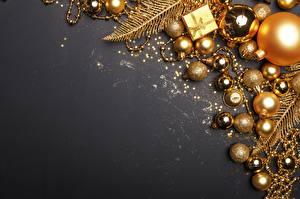 Фотографии Украшения Игрушки Новый год Шарики Золотых