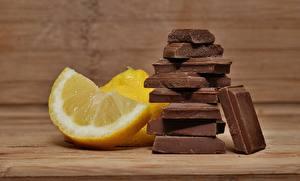 Фотография Лимоны Шоколад Кусочки Еда
