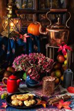 Фотографии Натюрморт Чайник Тыква Свечи Букет Мясные продукты Корица Кружка Еда