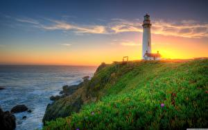 Картинка Штаты Рассвет и закат Берег Маяк Небо Калифорнии Траве Pigeon Point Lighthouse Природа
