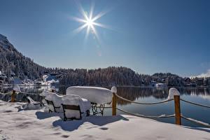 Обои Австрия Озеро Зимние Снега Забором Солнце Лучи света Turracher See, Styria Природа