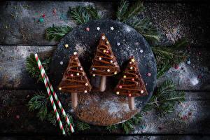 Фотография Новый год Шоколад Сладости Доски Елка Еда