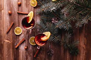 Фотография Новый год Корица Лимоны Орехи Напитки Доски Ветки