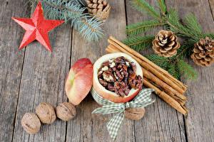 Фото Новый год Корица Орехи Яблоки Доски Ветки Шишки Звездочки Еда