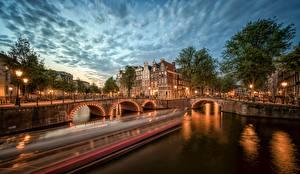 Обои Вечер Нидерланды Амстердам Мосты Реки Водный канал Города