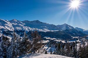 Обои для рабочего стола Гора Зимние Швейцария Альп Солнца Лучи света Снега Lenzerheide-Valbella, Canton Graubünden Природа