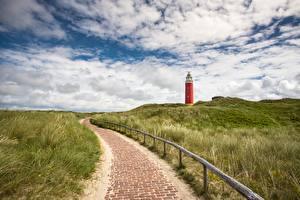 Фотографии Голландия Маяк Небо Траве Тротуар Eierland Lighthouse, Texel island