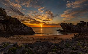 Картинка Рассвет и закат Пейзаж Море Небо Солнца Пляжа Облачно Природа