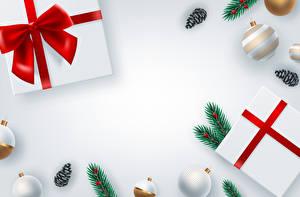Фотографии Векторная графика Новый год Серый фон Подарки Бантик Ветки Шарики Шишки Шаблон поздравительной открытки