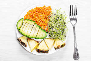 Картинки Овощи Авокадо Ананасы Тарелке Вилки Нарезка Пища