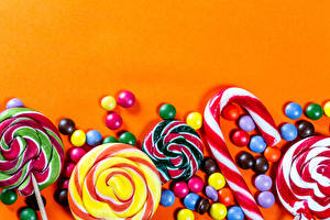 Обои Конфеты Сладкая еда Леденцы Драже Цветной фон Шаблон поздравительной открытки Еда