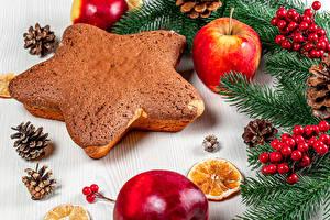Картинка Рождество Ягоды Печенье Яблоки На ветке Шишки Звездочки Пища