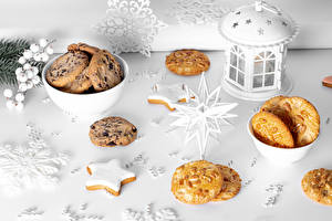 Картинка Рождество Печенье Свечи Снежинки Звездочки Продукты питания