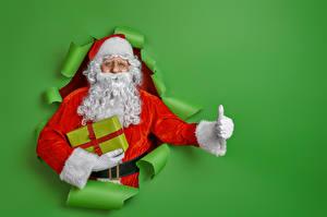 Фотография Новый год Пальцы Цветной фон Дед Мороз Борода Подарки