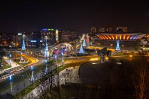 Обои Рождество Польша Здания Дороги Новогодняя ёлка Уличные фонари Электрическая гирлянда Ночные Улице Katowice город